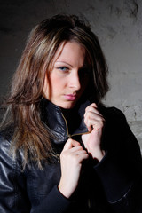 portrait young woman in leather jacket
