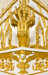 Head of golden Naga in blue sky