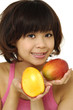 close up smile young woman holding ripe mango