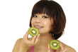 Closeup beauty woman holding kiwi