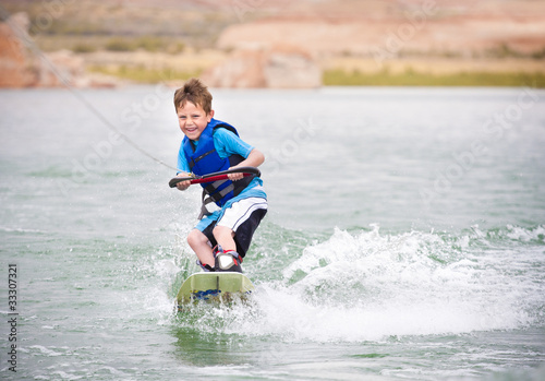 Young Boy learning to Wakeboard