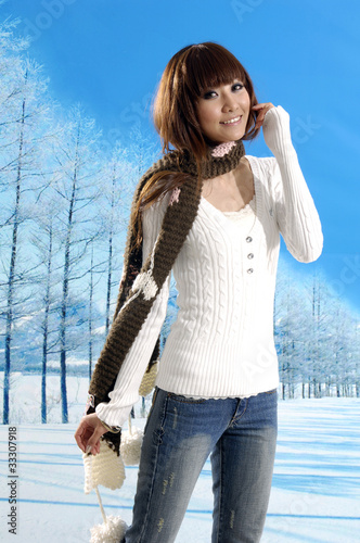Young asian fashion woman posing in winter snowy park