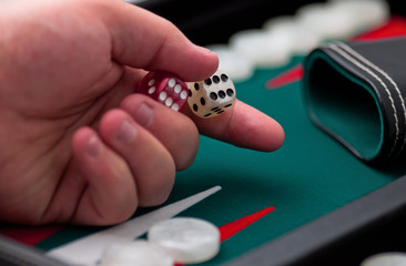 backgammon - hand and dice - close up