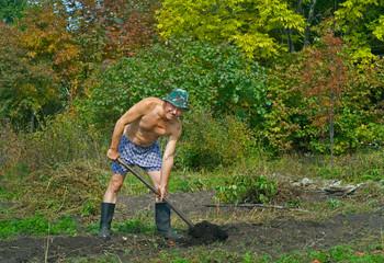 Man digs with spade 2