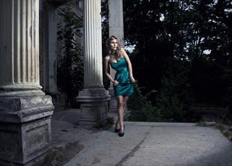 beautiful blonde woman posing in green dress