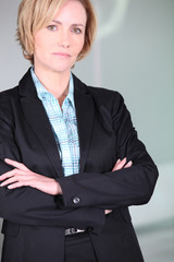Unimpressed woman with her arms folded