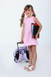 Young girl with a rucksack and file