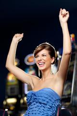 glamourous woman celebrating winning