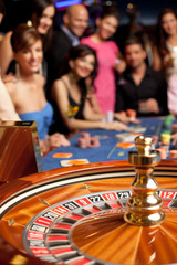 group of young people playing roulette