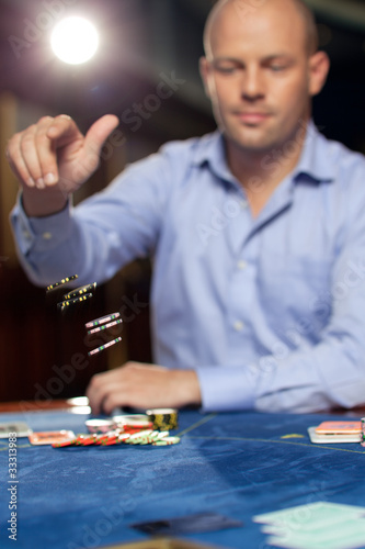 confident poker player chip thrower