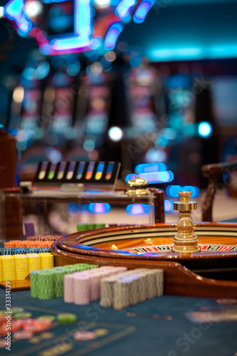 roulette wheel table with chips piles