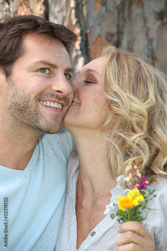 Romantic couple with wild flowers