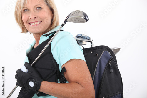 elderly woman liking golf