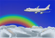 plane in blue sky with rainbow