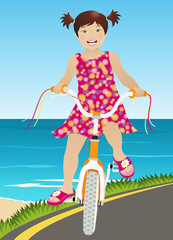 Girl riding a bicycle with sea on background