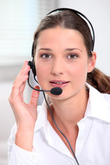 Portrait of a pretty secretary with headset