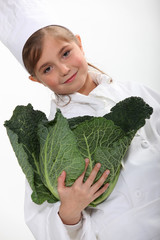 Girl carrying a cabbage head
