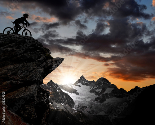silhouette of a biker in the Swiss Alps