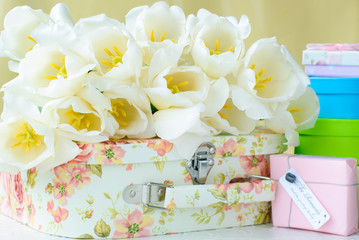 white tulips and gift boxes