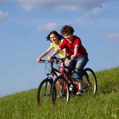 Girl and boy riding bikes