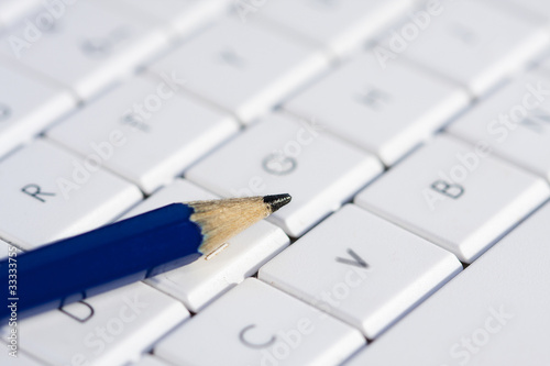 writer's tools, computer and pencil
