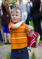 Little boy with rucksack on a back