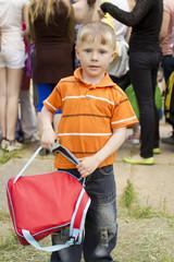Little boy with rucksack in hands