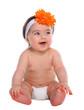 Baby girl smiling in diaper