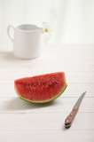 watermelon on a white wood table in the kitchen