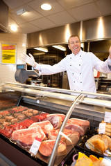 Fresh meat with cheerful butcher