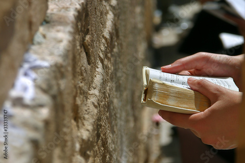 Leinwanddruck Bild Prayer holds Torah during prayer at Western Wall.