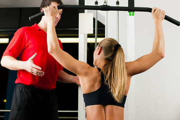 Woman with Personal Trainer in gym