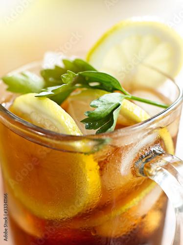 iced tea with lemon slice and leaf garnish.
