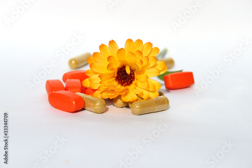 calendula flowers with pills