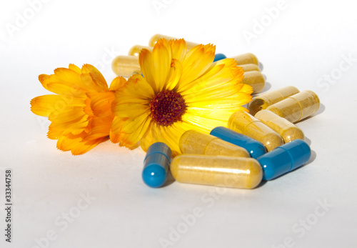 Medical pills and tablets with calendula flowers