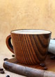 coffee cappuccino in a stylish wooden cup