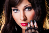Beautiful brunette girl with fine art lacy manicure on black poster