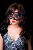 Attractive brunette woman with lacy mask poster