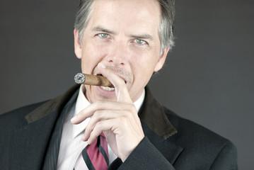 Confident Businessman Smokes Cigar