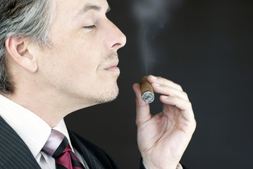 Businessman Smells Cigar, Side