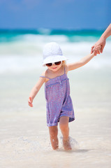 Little cute girl at beach