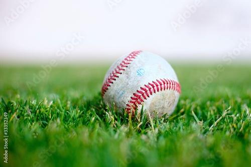 Baseball on a green grass field