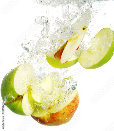 Foto op Canvas Opspattend water Colorful apples falls into water