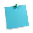 Blauer Merkzettel mit grünem Pin