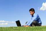 businessman with laptop at the park