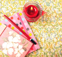 Notebooks and candle