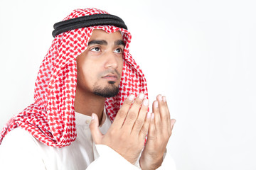 Young arab muslim praying dua