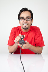 Geek playing old video game with controller in hand