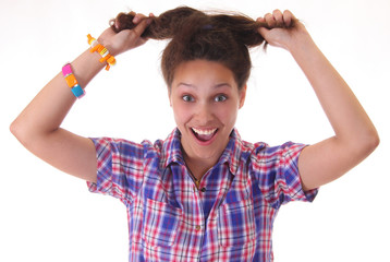 A funny young girl with bizarre hairstyle