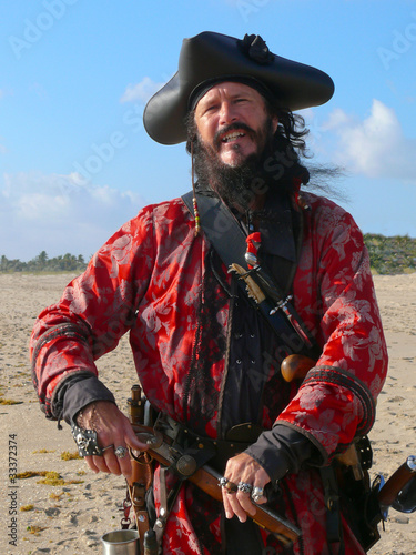 Pirate with weapons on the beach